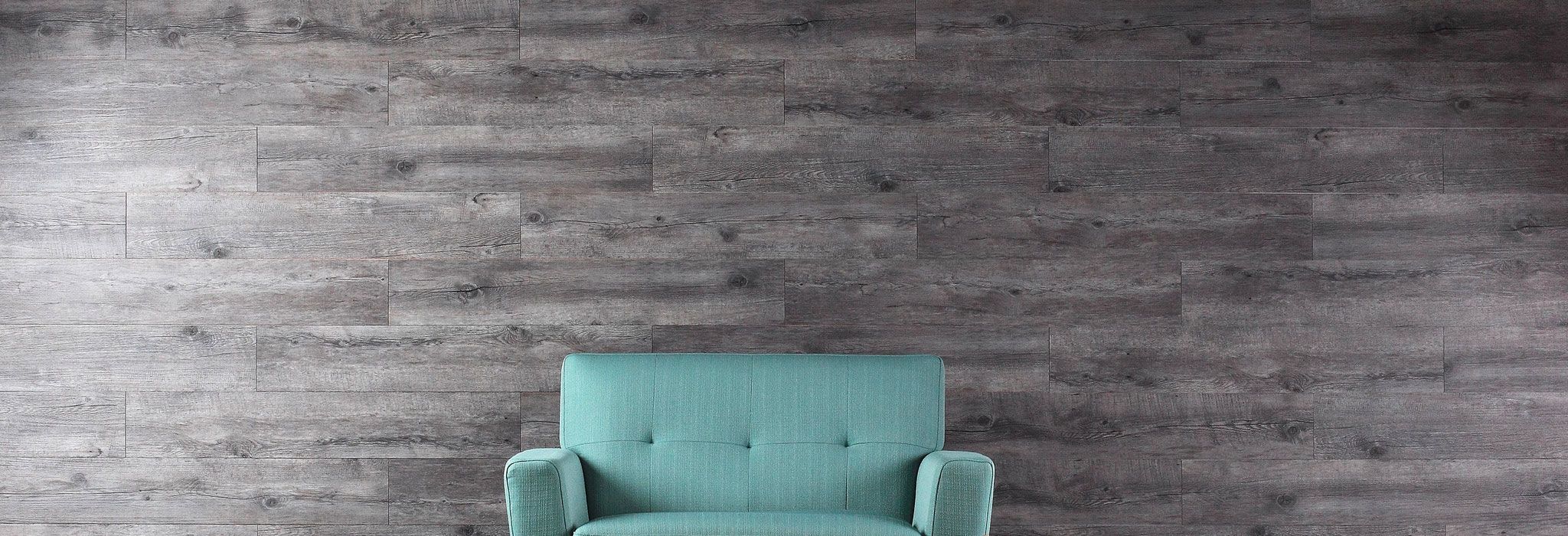 Wooden background with a sofa placed in front